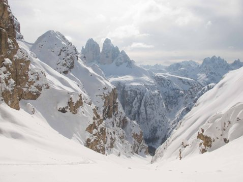 Skitouring on forcella Rondoi, with 3 Cime in the background