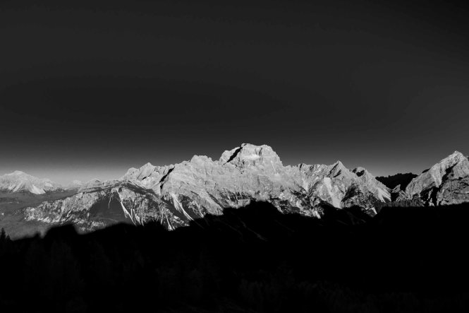 Black and white sunset on monte Sorapis, with the shadow of averau