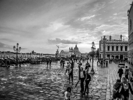 People from Venice after the rain, picture taken in black and white.