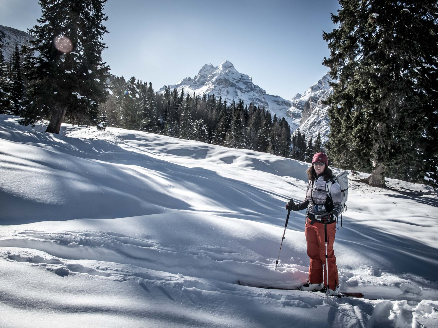 Ski-touring in the woods towards Lerosa with Tofana in the background.