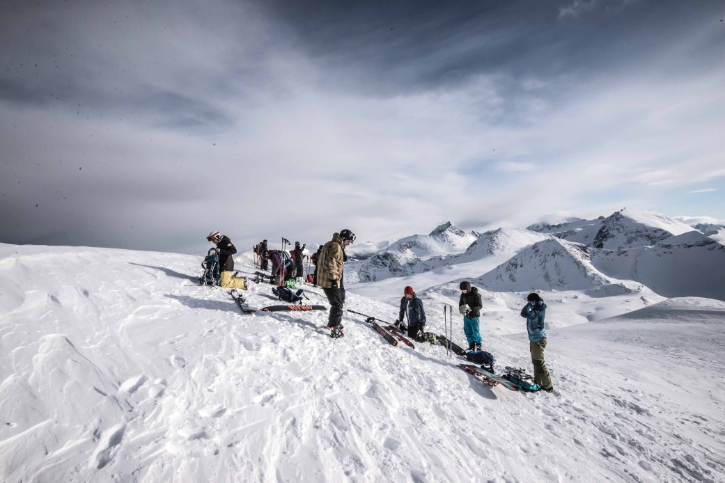 Splitboarders on top of Russelvfjellet getting ready for the descent, Lyngen alps in the background.