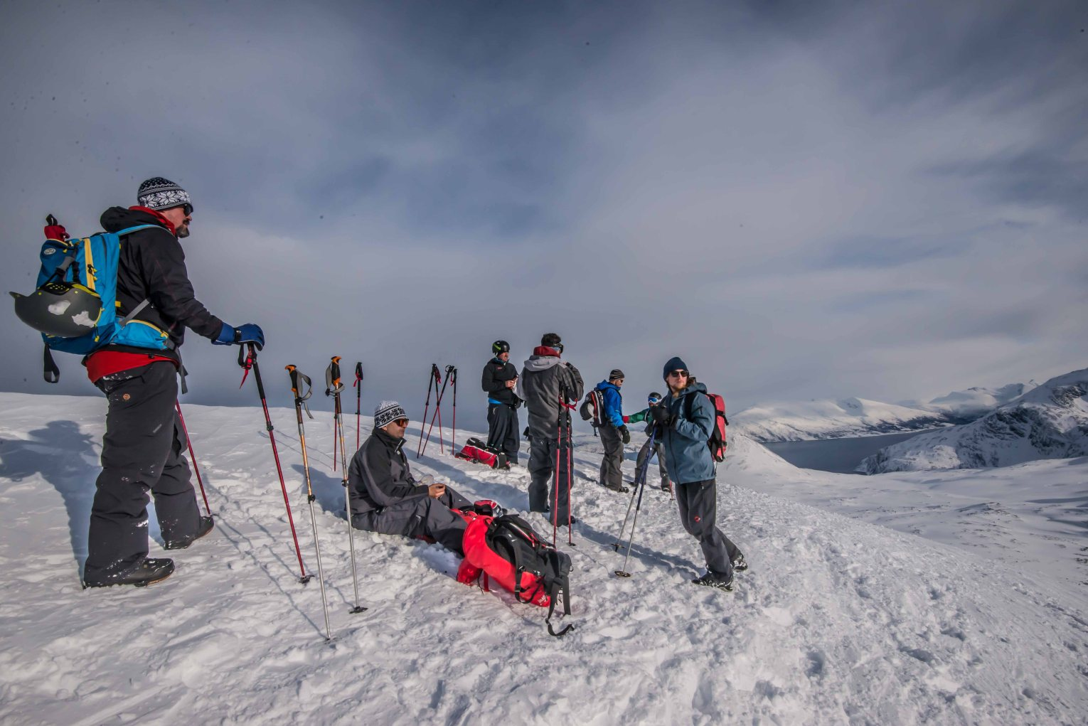 The group is on top of Russelvfjellet, ready for snowboarding.