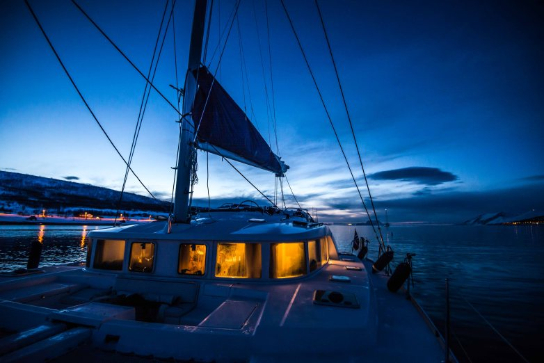 Evening outside the catamaran in the fjord