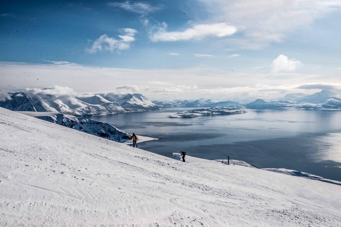 The groub is climbing to the summit of Trolltinden, in Arnøya.