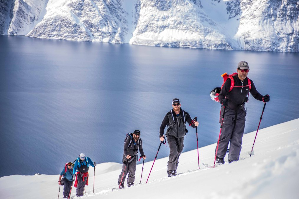 Skitouring in Lyngen area, Norway; with the fjord in the back.
