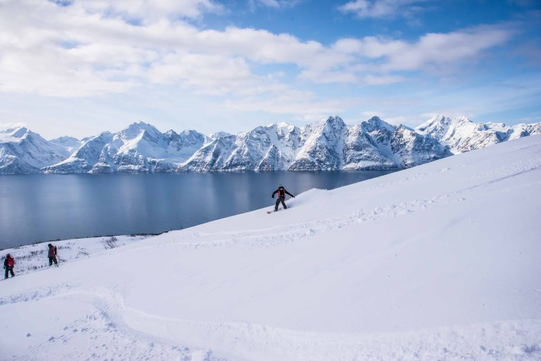Taylor snowboarding from the Storhaugen with an amazing view of the Lyngen Alps.