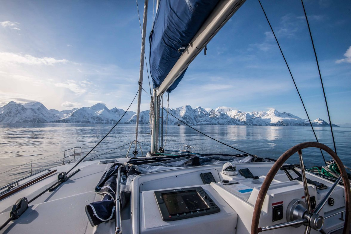 The catamaran is pointed toward Lyngen Alps.