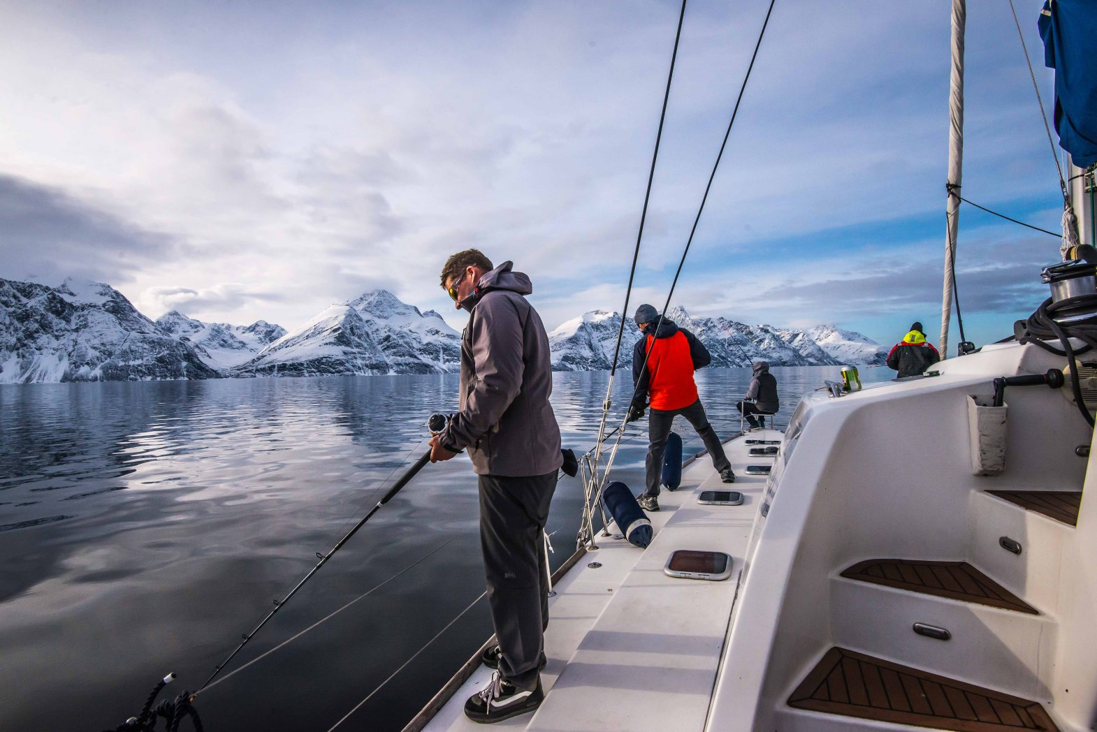 Fishing from the catamaran with the Lyngen alps in the background.