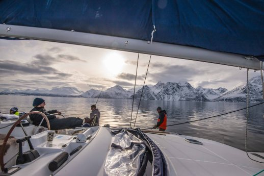 Clients fishing in the Lyngen fjord, while Captain Jonas is having his coffee.